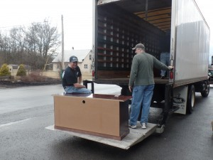loading furniture into truck, office relocation, log homes, log cabin homes, log cabins, post and beam homes, timberframe homes, timber frame homes, laminated logs, engineered logs, floor plan designs, kiln dried logs, Timberhaven local reps, log homes in Pennsylvania, log homes in PA, Timberhaven Log Homes, Timberhaven Log & Timber Homes