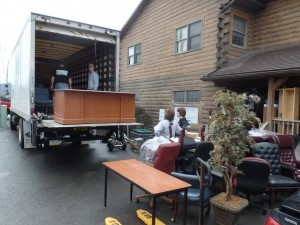group loading furniture onto truck, office relocation, log homes, log cabin homes, log cabins, post and beam homes, timberframe homes, timber frame homes, laminated logs, engineered logs, floor plan designs, kiln dried logs, Timberhaven local reps, log homes in Pennsylvania, log homes in PA, Timberhaven Log Homes, Timberhaven Log & Timber Homes