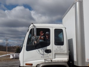 guy waving from big truck, office relocation, log homes, log cabin homes, log cabins, post and beam homes, timberframe homes, timber frame homes, laminated logs, engineered logs, floor plan designs, kiln dried logs, Timberhaven local reps, log homes in Pennsylvania, log homes in PA, Timberhaven Log Homes, Timberhaven Log & Timber Homes