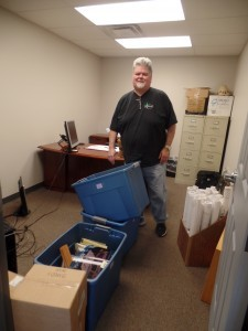 guy moving boxes into office space, office relocation, log homes, log cabin homes, log cabins, post and beam homes, timberframe homes, timber frame homes, laminated logs, engineered logs, floor plan designs, kiln dried logs, Timberhaven local reps, log homes in Pennsylvania, log homes in PA, Timberhaven Log Homes, Timberhaven Log & Timber Homes