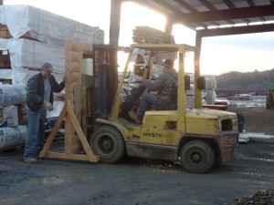 forklift moving log dispaly, making great progress, log homes, log cabin homes, log cabins, post and beam homes, timberframe homes, timber frame homes, laminated logs, engineered logs, floor plan designs, kiln dried logs, Timberhaven local reps, log homes in Pennsylvania, log homes in PA, Timberhaven Log Homes, Timberhaven Log & Timber Homes