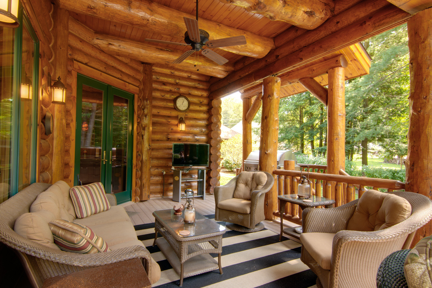 Outdoor entertainment areas for your log home for Log cabin porch