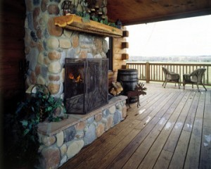 deck with outdoor fireplace, Outdoor entertainment areas, log homes, log cabin homes, log cabins, post and beam homes, timberframe homes, timber frame homes, laminated logs, engineered logs, floor plan designs, kiln dried logs, Timberhaven local reps, log homes in Pennsylvania, log homes in PA, Timberhaven Log Homes, Timberhaven Log & Timber Homes