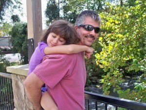 daughter being carried on father's back, Ken Holmes, employee spotlight, Timberhaven Log & Timber Homes, Timberhaven, log homes, Middleburg, PA