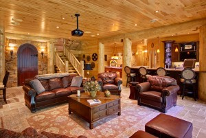 leather furniture in home theater room, Indoor entertainment areas, log homes, log cabin homes, log cabins, post and beam homes, timberframe homes, timber frame homes, laminated logs, engineered logs, floor plan designs, kiln dried logs, Timberhaven local reps, log homes in Pennsylvania, log homes in PA, Timberhaven Log Homes, Timberhaven Log & Timber Homes