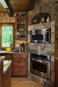 built in kitchen appliances surrounded by stone, innovative kitchen appliances, log homes, log cabin homes, log cabins, post and beam homes, timberframe homes, timber frame homes, laminated logs, engineered logs, floor plan designs, kiln dried logs, Timberhaven local reps, log homes in Pennsylvania, log homes in PA, Timberhaven Log Homes, Timberhaven Log & Timber Homes