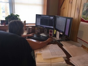 woman sitting at desk working on AutoCAD, wendi zimmerman-roush, log homes, log cabin homes, log cabins, post and beam homes, timberframe homes, timber frame homes, laminated logs, engineered logs, floor plan designs, kiln dried logs, Timberhaven local reps, log homes in Pennsylvania, log homes in PA, Timberhaven Log Homes, Timberhaven Log & Timber Homes