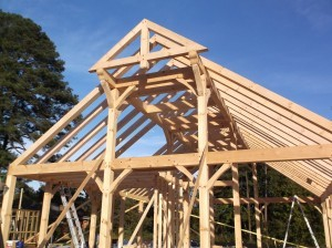 timber frame structure being built, handcrafter talks timber frame