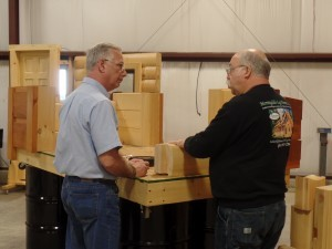 sales rep meets with customer, 2017 log home events, log homes, log cabin homes, log cabins, post and beam homes, timberframe homes, timber frame homes, laminated logs, engineered logs, floor plan designs, kiln dried logs, Timberhaven local reps, log homes in Pennsylvania, log homes in PA, Timberhaven Log Homes, Timberhaven Log & Timber Homes