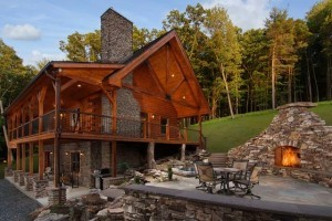 log cabin with huge fireplace and outdoor fire pit, cabin living, log homes, log cabin homes, log cabins, post and beam homes, timberframe homes, timber frame homes, laminated logs, engineered logs, floor plan designs, kiln dried logs, Timberhaven local reps, log homes in Pennsylvania, log homes in PA, Timberhaven Log Homes, Timberhaven Log & Timber Homes