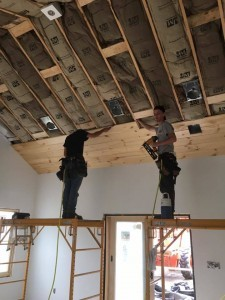 two working installing tongue and groove on ceiling, Bitter sweet dream home, log homes, log cabin homes, log cabins, post and beam homes, timberframe homes, timber frame homes, laminated logs, engineered logs, floor plan designs, kiln dried logs, Timberhaven local reps, log homes in Pennsylvania, log homes in PA, Timberhaven Log Homes, Timberhaven Log & Timber Homes