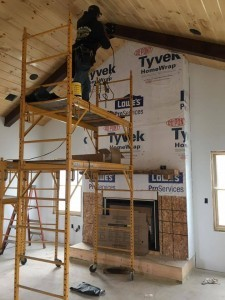 guy installing beam on ceiling, Bitter sweet dream home, log homes, log cabin homes, log cabins, post and beam homes, timberframe homes, timber frame homes, laminated logs, engineered logs, floor plan designs, kiln dried logs, Timberhaven local reps, log homes in Pennsylvania, log homes in PA, Timberhaven Log Homes, Timberhaven Log & Timber Homes