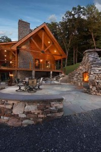 outdoor patio area with fireplace, Best home, log homes, log cabin homes, log cabins, post and beam homes, timberframe homes, timber frame homes, laminated logs, engineered logs, floor plan designs, kiln dried logs, Timberhaven local reps, log homes in Pennsylvania, log homes in PA, Timberhaven Log Homes, Timberhaven Log & Timber Homes