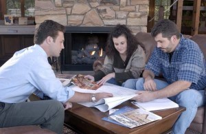couple working with designer over a set of plans, welcome, log homes, log cabin homes, log cabins, post and beam homes, timberframe homes, timber frame homes, laminated logs, engineered logs, floor plan designs, kiln dried logs, Timberhaven local reps, log homes in Pennsylvania, log homes in PA, Timberhaven Log Homes, Timberhaven Log & Timber Homes