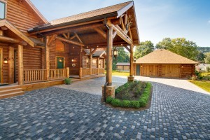 Towering Log Home Portico with Style, incorporating wood materials, custom outdoor structures, outdoor wooden structures
