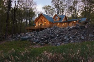 a log home on a rock embankment, log home living, log homes, log cabin homes, log cabins, post and beam homes, timberframe homes, timber frame homes, laminated logs, engineered logs, floor plan designs, kiln dried logs, Timberhaven local reps, log homes in Pennsylvania, log homes in PA, Timberhaven Log Homes, Timberhaven Log & Timber Homes