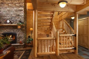 log railing and balusters, Exposed Heavy Timber Stairway, Half log handcrafted stair systems, custom stairs in log home, stair systems, wooden stair systems, custom stair systems, custom stairs, wooden stairs, Timberhaven stair options