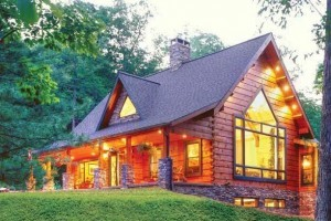 custom log home in woods, solid log home, differences, log vs. timber frame homes, different home design options, log homes, log cabin homes, log cabins, post and beam homes, timberframe homes, timber frame homes, laminated logs, engineered logs, floor plan designs, kiln dried logs, log homes in PA, Timberhaven Log Homes, Timberhaven Log & Timber Homes