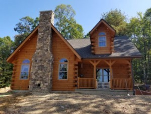 log home in the woods with stone chimney, log home dreams, log homes, log cabins, timber frame homes, laminated logs, engineered logs, floor plan designs, kiln dried logs, log cabins in Pennsylvania, Timberhaven Log Homes, Timberhaven Log & Timber Homes