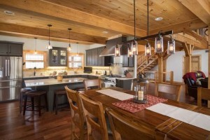 timber frame kitchen and dining area, wide open spaces, trendy tiles, log homes, timber frame homes, timber homes, Timberhaven, tiles for custom homes, Timber Frame Open Living Areas