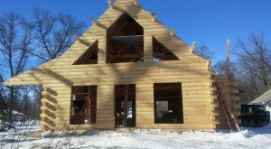 log cabin under construction, suggestions for building a log home in the winter, log homes, log home under construction, log cabins, winter build, Timberhaven, kiln dried logs, engineered logs