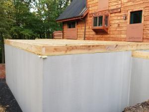 Log Home Addition Foundation Prep, Log Home Addition to Existing Log Home, log home additions, timber frame home additions, Timberhaven, home additions with wood, log homes, Engineered logs