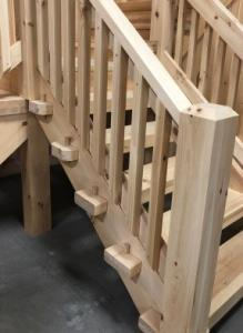 timber pegged stair systems, Half log handcrafted stair systems, custom stairs in log home, stair systems, wooden stair systems, custom stair systems, custom stairs, wooden stairs, Timberhaven stair options