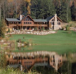 very large log home by a pond, Log Home Addition to Existing Log Home, log home additions, timber frame home additions, Timberhaven, home additions with wood, log homes, Engineered logs