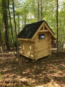 logo cabin outhouse in the woods, log cabin loo, log outhouse, log loo, outhouse off the grid, unique outhouse, unique log cabin, log cabin home, log cabins, log homes, timber frame homes, Engineered Logs, Timberhaven Log & Timber Homes
