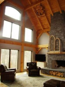 interior of timber frame living room, timber frame homes, Timberhaven Log & Timber Homes, kiln-dried timbers, timber homes, timberframe homes, timber frame house, customer testimonial