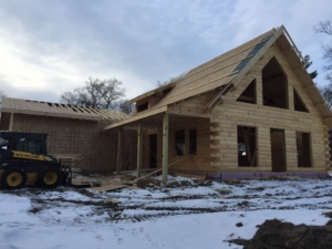 roof installation log cabin, suggestions for building a log home in the winter, log homes, log home under construction, log cabins, winter build, Timberhaven, kiln dried logs, engineered logs
