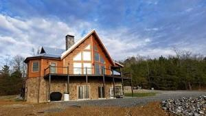 log home in Tennessee, dream log home, customer testimonial, log homes, log cabin homes, log home plans, Timberhaven, kiln dried, engineered logs, modified Aspen Hill