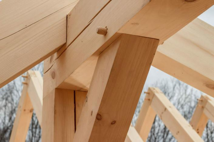 Timber frame angle brace and pegs
