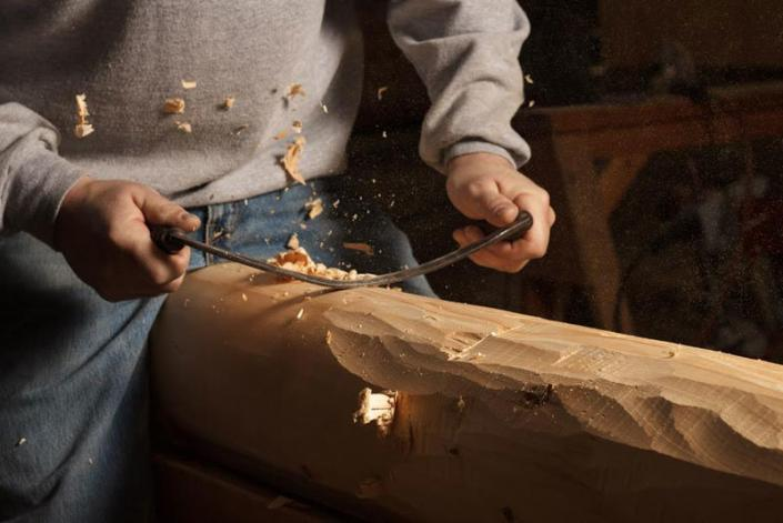 Timberwright hand hewning timber