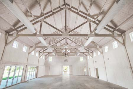 massive post and beam trusses inside building, timber truss, Glenmere Events Center, timber accents, post and beam construction, commercial projects, Timberhaven, engineered timbers, kiln dried timbers