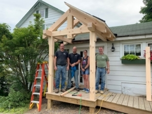 group of people working on porch, pay it forward, random acts of kindness, kindness matters, RAKs, Timberhaven, community support, middleburg, PA