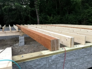girder beam and floor joists for foundation, new model log home, foundation, crawlspace, foundation for new log home, log home foundation