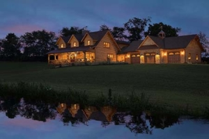 Cape Cod Log Home with garage at dusk, log home, log cabin, log cabin home, Timberhaven, a step in time, PA log homes